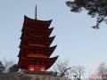 Tall bright red pagoda at Miyajima