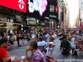 Folks enjoying the last of summer along Broadway and Times Square