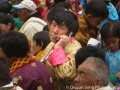 Bhutanese woman on a cellphone while at the Paro Tsechu Festival
