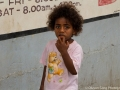 Adorable girl at the local produce market in Fiji