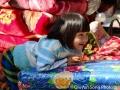 An adorable Burmese girl at a market by Inle